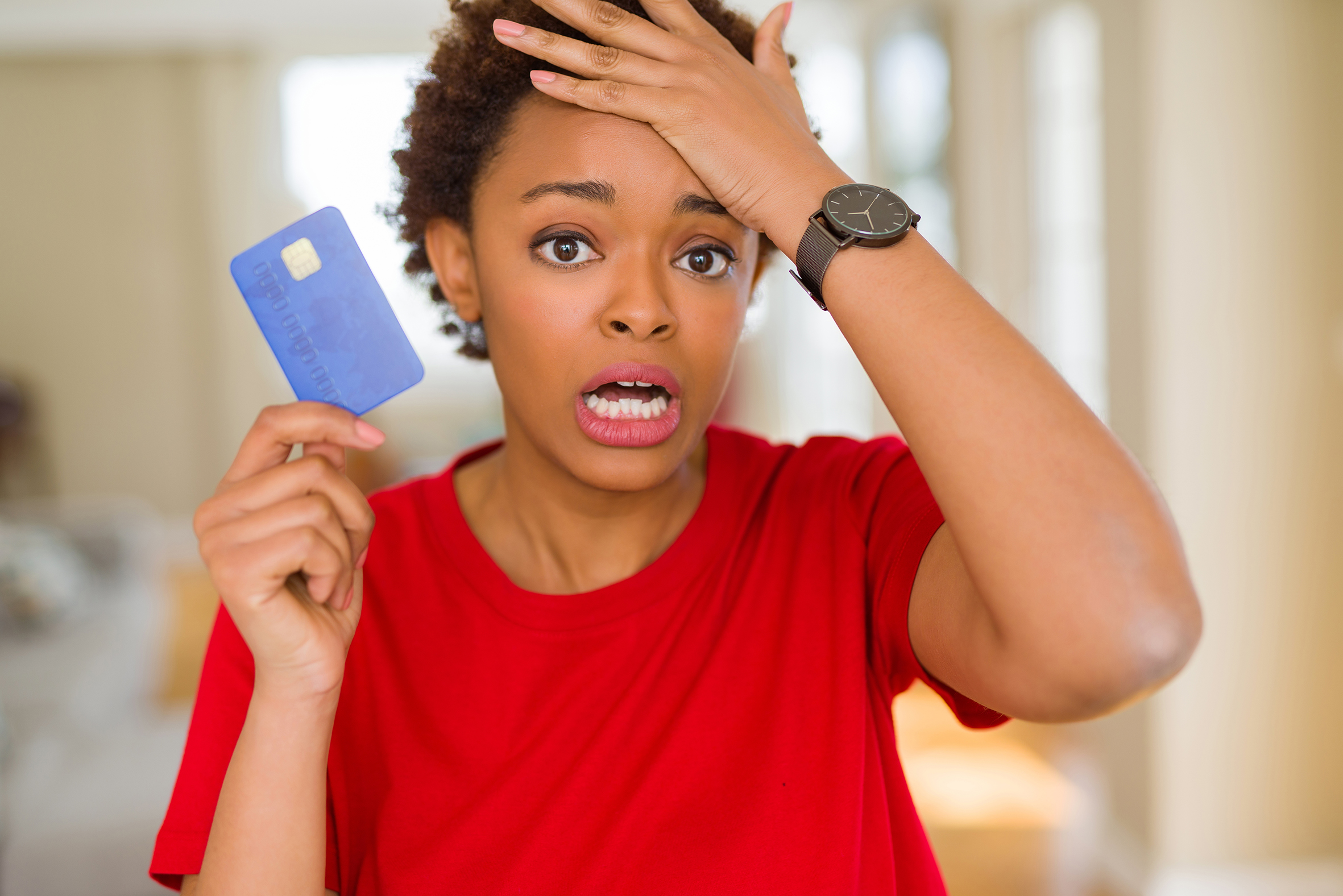 Credit card issuers lower cardholder limits, close accounts